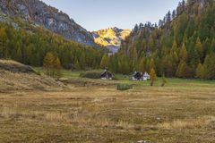 Alpe devero autumnal mountain landscape. Sunset over the Lake of the witches inside the Alpe Devero flat land stock photos