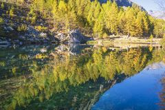 Alpe devero autumnal mountain landscape. Sunset over the Lake of the witches inside the Alpe Devero flat land royalty free stock image