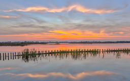 Sunset Over Lake With Riverbank Campshedding Stock Image