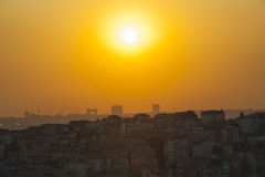 Sunset over a large cityscape Stock Photo