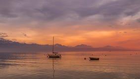 Sunset over the Leman lake. Beautiful sunset at the lake Leman. City of Lausanne, Switzerland Royalty Free Stock Image