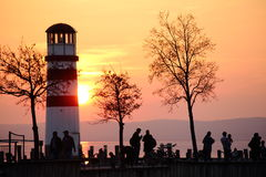 Sunset over a lighthouse stock images