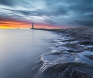 Sunset over the lighthouse Stawa Mills, Swinoujscie Stock Image