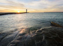 Sunset over the lighthouse Stawa Mills, Swinoujscie Stock Images