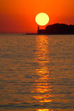 Sunset over lighthouse in Zadar Royalty Free Stock Images