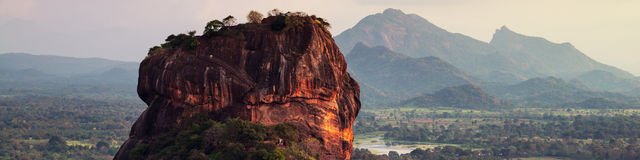 Sunset over the Lion Rock in Sigiriya, Sri Lanka. Aerial view of the tropical forest with mountains Royalty Free Stock Photography