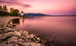 Sunset over a little church in Liptov, Slovakia stock photos