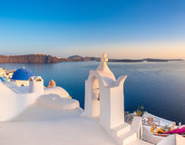 Sunset over local church in Oia, Santorini, Greece Stock Images
