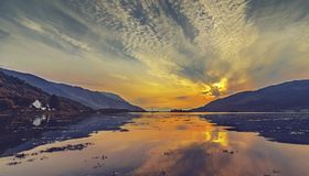 Sunset over Loch Leven Harbour in Scottish Highlands royalty free stock photography