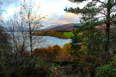 Sunset over Loch Lomond. Magnificent sunset view of Loch Lomond in the Scottish Highlands during autumn Stock Image