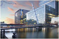 Sunset over London city. Workers stream across the bridge at the end of a busy day in London's Financial Services Centre Royalty Free Stock Photo