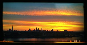 Sunset over London. London sunset in the spring - orange stock image