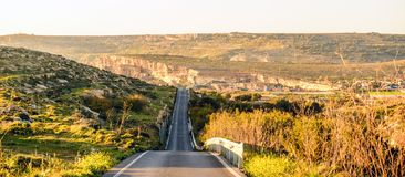 Sunset over a long deserted road in Malta Stock Image