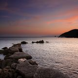 Sunset over Looe Island from Portwrinkle, Cornwall royalty free stock photography