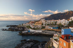 Sunset over Los Gigantes cliffs and resorts of Puerto Santiago Stock Photography