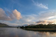 Sunset over Lough Leane [Lake Leane] with water lillies on the Ring of Kerry in Killarney Ireland. Sunset over Lough Leane [Lake Leane] with water lillies on the royalty free stock photography