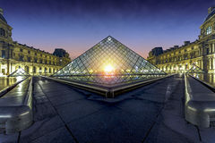 Sunset over the Louvre Museum Paris Stock Photo