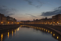 Sunset over the lungarno pisa, tuscany, italy, europe Royalty Free Stock Photos