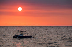 Sunset over Madagascar Nosy be beach with boat silhouette royalty free stock photos