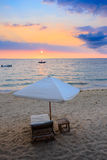 Sunset over Madagascar Nosy be beach with sunlounger stock photography