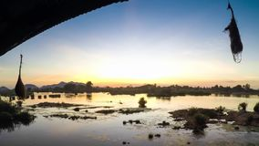 Sunset over a major tributary of the Amazon - the Rio Napo in Ecuador - Timelapse stock video footage