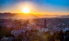 Sunset over the Malaga city Stock Photos