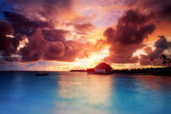 Sunset over Maldives islands Royalty Free Stock Image