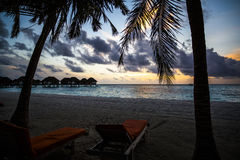 Sunset over Maldives resort beach Royalty Free Stock Photography