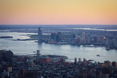 Sunset over Manhattan, New York, and downtown Jersey City. Aerial view of New York and Jersey City, spanning Chelsea, Hudson River and Ellis Island in New York Royalty Free Stock Photos