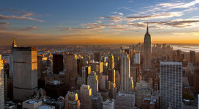 Sunset over manhattan royalty free stock images