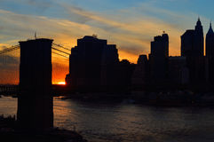 Sunset over a Manhattan. Silhouette of Manhattan skyline with Brooklyn Bridge at sunset Royalty Free Stock Photography