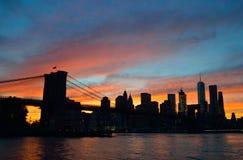 Sunset over a Manhattan. Silhouette of Manhattan skyline with Brooklyn Bridge at sunset Stock Photo