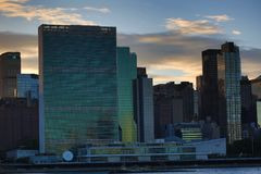 Sunset over Manhattan skyline UN building. View from the Queens on sunset over Manhattan skyline. Hunters npoint location Stock Photo