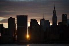 Sunset over Manhattan skyline. Royalty Free Stock Images