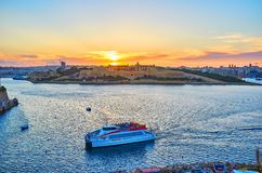 Sunset over the Manoel Fort, Valletta, Malta. VALLETTA, MALTA - JUNE 17, 2018: The sunset sky above the medieval Manoel Fort, located on the same named island Royalty Free Stock Photos