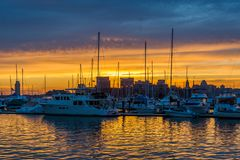Sunset over a marina in Canton, Baltimore, Maryland.  stock images