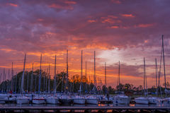 Sunset over marina. Colorfull sunset over sail boats in a marina stock photos