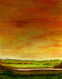 Sunset Over Meadows. A watercolour painting of a field at sunset Stock Images