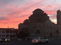 Sunset over a Mediterranean church. Ornate building with sunset Stock Photography