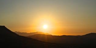 Sunset over a Mediterranean mountain range Royalty Free Stock Photos