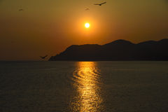 Sunset over the mediterranean sea Stock Images
