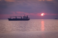 Sunset over Mediterranean sea. A ship crossing Meditrranean sea at sunset Stock Images