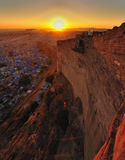 Sunset over mehrangarh fort in jodphur,rajasthan,i. The sun setting over the ramparts of mehrangarh fort in jodphur,rajasthan,india Royalty Free Stock Images
