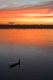 Sunset over Mekong river. Colorful sky at sunset over Mekong river, fisherman boat Stock Photos