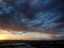 Sunset over Melbourne. Dramatic sunset with Melbourne CBD in the distance Royalty Free Stock Photos
