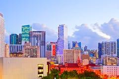 SUnset over Miami Florida skyline with illuminated modern buildings Stock Photo