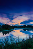 Sunset Over A Misty River. Calm autumn nights form dramatic sunsets over the river royalty free stock photography