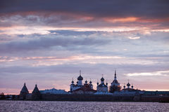 Sunset over Monastery. View on Solovetsky Monastery with Holy Lake on sunset stock image