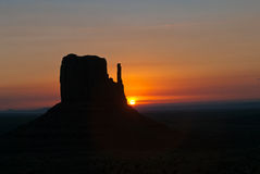 Sunset over Monument Valley. Scenic view of golden sunset over butte rock formation in Monument Valley, Utah, U.S.A Royalty Free Stock Photos