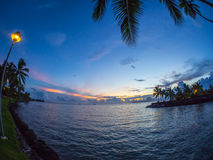 Sunset over Moorea Island, Intercontinental Resort and Spa Hotel in Papeete, Tahiti, French Polynesia. Intercontinental Resort and Spa hote located on the main Stock Photography